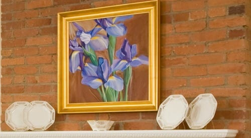 beautiful original art in DC - flowers over the fireplace